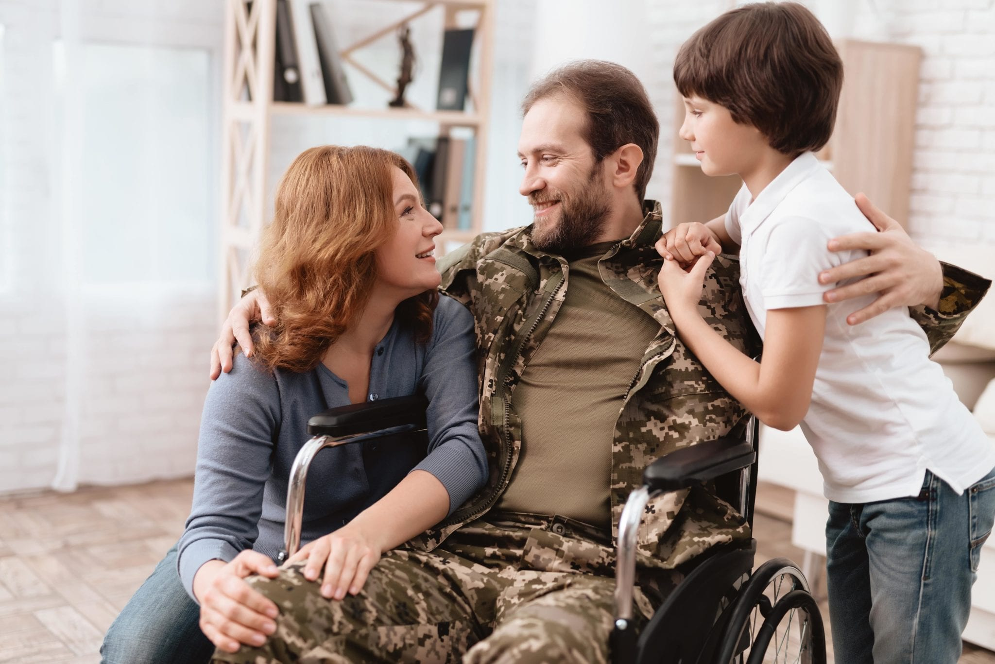 small business loans for disabled veterans hugging family through business financing