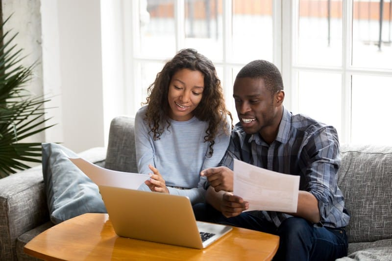 couple sitting at desk with credit