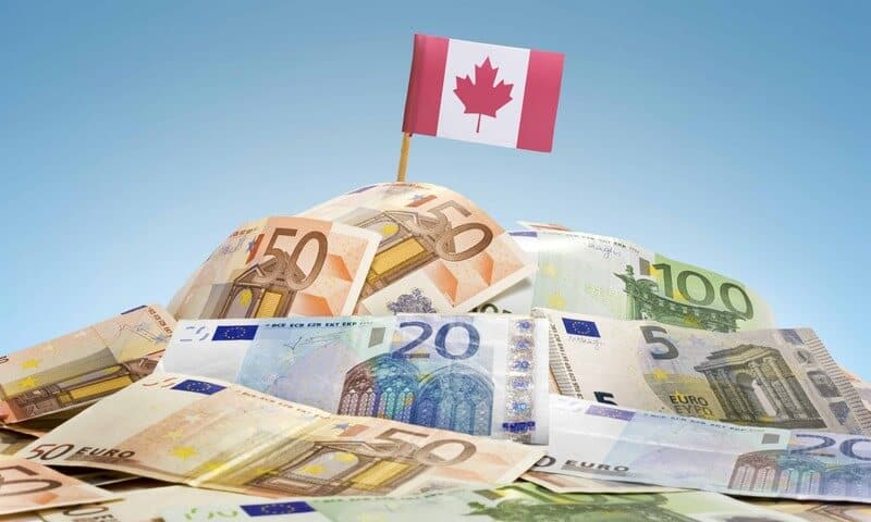 canadian flag on pile of money
