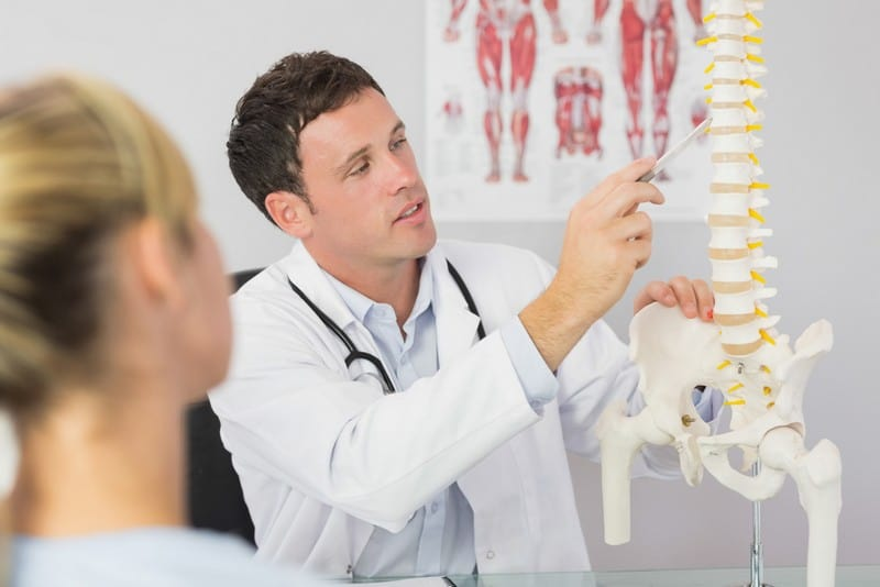 chiropractor working with patient